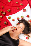 Eating a Strawberry Stock Images