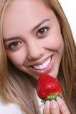 eating strawberry woman 图库摄影