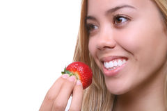 eating strawberry woman Royaltyfria Foton