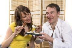 Eating sushi Stock Images
