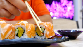 Eating sushi. With chop sticks Stock Photo