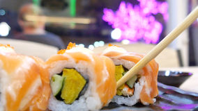 Eating sushi. With chop sticks Stock Images