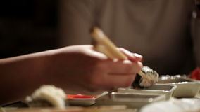 Eating sushi at home. Close up detail. stock video footage