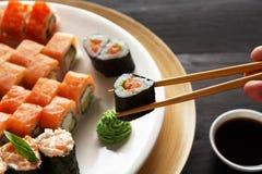Eating sushi rolls at japanese food restaurant Stock Image