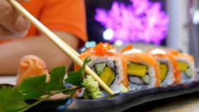 Eating Sushi rolls in a restaurant. Japanes food Royalty Free Stock Photo