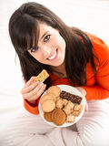 Eating sweet food in bed Stock Photography