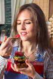 Eating sweet preserves. Stock Photography