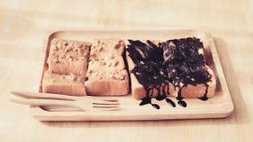 Eating sweet toast. Stock Image