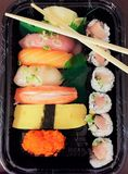 Eating takeout sushi Royalty Free Stock Image