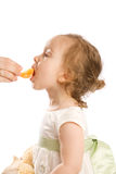 Eating tangerine Royalty Free Stock Photos