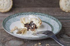 Eating tasty home baked Christmas mince pies freshly baked Royalty Free Stock Images