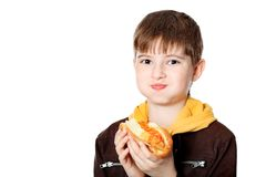 Eating teenager. Shot of a hungry boy with a tasty hot dog Stock Photos