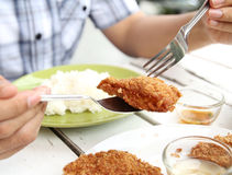 Eating Thai foood. Closeup image of a man eating Thai food fried shrimp cake stock photo