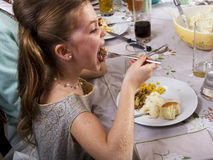 Eating Thanksgiving Dinner Turkey. Young girl eats Thanksgiving dinner turkey stock photography