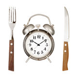 Eating time. Concept. Alarm clock, knife and fork isolated on white backround royalty free stock photos