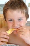 Eating toast. Boy eating toast Stock Photos