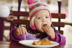 Eating  toddler girl Royalty Free Stock Photography
