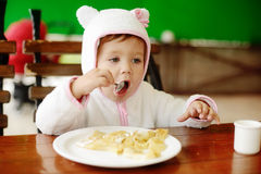 Eating toddler girl Stock Photos