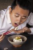 Eating tofu Stock Photography