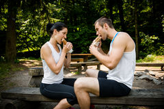 Eating together -  couple after jogging Royalty Free Stock Photos
