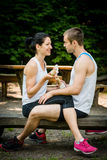 Eating together -  couple after jogging Royalty Free Stock Photo