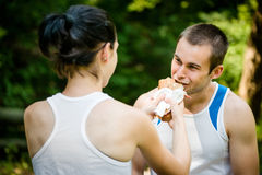Eating together -  couple after sport training Royalty Free Stock Image