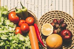 Fruits and vegetables are in the basket. Eating and traditional breakfast concept stock photography