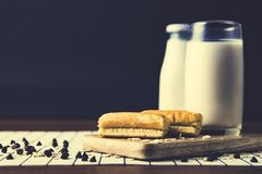 A glass of soy milk,soy beans in a bowl on wooden board. Eating and traditional breakfast concept royalty free stock image