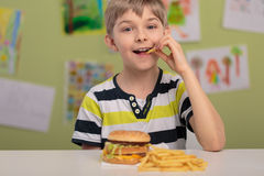 Eating unhealthy fries Royalty Free Stock Photography