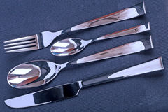 Eating utensils on a black fabric Stock Images