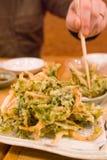 Eating vegetable tempura Royalty Free Stock Photography