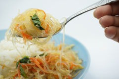 Eating Vegetarian fried vermicelli with rice. Eating Vegetarian fried vermicelli gives you strong and healthy Royalty Free Stock Images