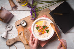 Eating vichyssoise soup on the white wooden table  top view Stock Photography