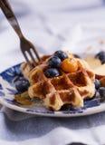 Eating waffle Stock Photos