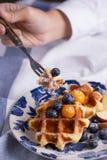 Eating waffle Stock Photo