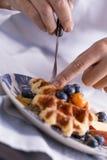 Eating waffle Royalty Free Stock Images