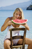 Eating water melon Stock Images