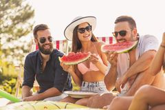 Eating watermelon at a poolside party royalty free stock photo
