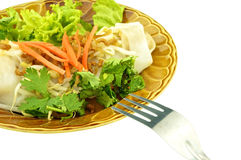 Eating wide rice noodle roll with fork isolated Royalty Free Stock Photos