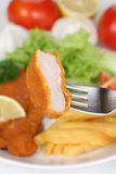 Eating Wiener Schnitzel chop cutlet with fork Royalty Free Stock Photography