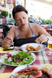 Eating woman Stock Images