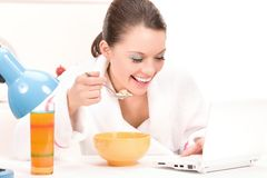 Eating woman laptop computer Royalty Free Stock Images