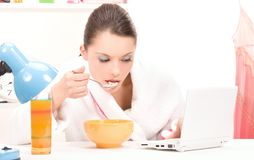Eating woman laptop computer Stock Images
