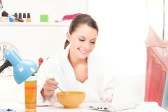 Eating woman with laptop computer Royalty Free Stock Image