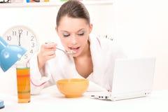 Eating woman laptop computer Stock Image