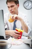 Eating at work Stock Photos