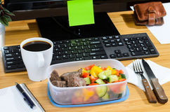 Eating at workplace Royalty Free Stock Photos