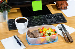 Eating at workplace Stock Images
