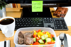 Eating at workplace Stock Photography