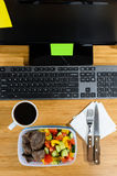 Eating at workplace Stock Photos